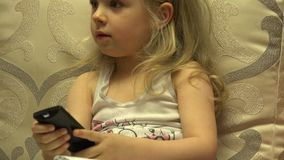 Intelligent Little Girl Press Remote Control, Channel Switching. 4K UltraHD, UHD stock video footage
