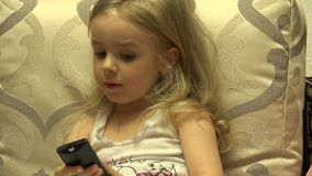 Intelligent Little Girl Press Remote Control, Channel Switching. 4K UltraHD, UHD stock footage