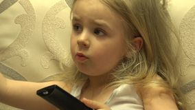 Intelligent Little Girl Press Remote Control, Channel Switching. 4K UltraHD, UHD stock video