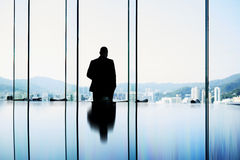 Intelligent male professional banker is standing in conference room Stock Image
