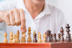 Intelligent man playing chess Stock Photography