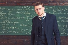 Intelligent man in suit standing in classroom. Aristocrats and elite concept royalty free stock image