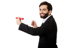 Intelligent man writing with big pencil. Royalty Free Stock Photos