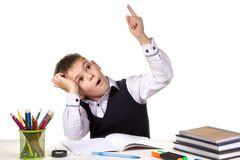 Intelligent pupil finally found the solution for exercise on the white background.  Royalty Free Stock Photos