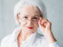 Intelligent senior lady professional success. Intelligent senior lady. Professional success. Closeup portrait of woman taking off eye glasses. Sceptic facial stock photos
