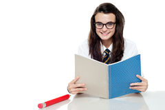 Intelligent student preparing for test. Read notes Royalty Free Stock Photos