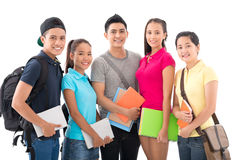 Intelligent students. Portrait of young intelligent students of the college smiling and looking at camera isolated on white royalty free stock photos