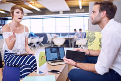 Intelligent woman busy explaining her perspective to attentive man Royalty Free Stock Photo