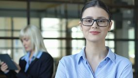 Intelligent woman in glasses posing on camera, employment of young professionals