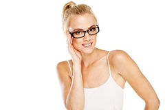 Intelligent woman wearing glasses. Smiling attractive intelligent woman wearing a pair of modern glasses with dark frames as a fashion accessory Royalty Free Stock Photo