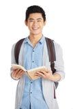Intelligenter asiatischer Student mit Buch stockfotos