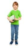Intelligenter Junge mit Büchern Stockbilder