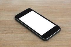 Intelligentes Telefon, das auf Holztisch liegt Stockbild