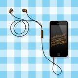 Intelligentes Telefon mit seinen Kopfhörern auf einer Tabelle Stockfoto