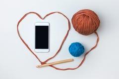 Intelligentes Telefon und T-Shirt Wolldecke Lizenzfreie Stockfotografie