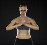 Intense Athletic Woman Holding Fist in Studio Royalty Free Stock Photo