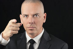 Intense Bald Man Points To Camera Stock Photos