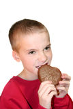 Intense Boy Biting Chocolate Heart 1 Royalty Free Stock Photography