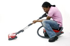 Intense cleaning. Young man doing intense cleaning Royalty Free Stock Photo