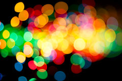Intense colorful lights. Intense colorful blurry lights on dark background Stock Images