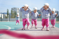Intense Competition Of Toddlers Close To The Finish Royalty Free Stock Photo