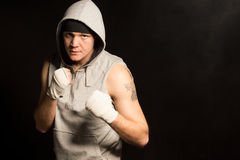 Intense determined young boxer Royalty Free Stock Photos
