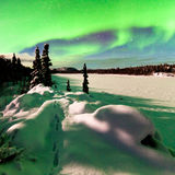 Intense display of Northern Lights Aurora borealis. Spectacular display of intense Northern Lights or Aurora borealis or polar lights forming green arc over Royalty Free Stock Photo