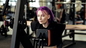 Intense workout focused woman training exercise stock footage