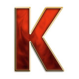 Intense k. Capital letter k in fiery red & gold isolated on white Stock Photography