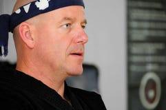 Intense Karate Master. Karate sensei looking intense as he teaches royalty free stock image