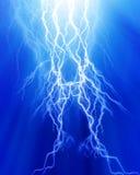 Intense lightning. On a blue background Royalty Free Stock Image
