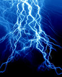 Intense lightning. On a dark blue background Royalty Free Stock Images