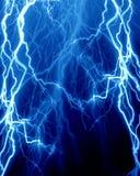 Intense lightning. On a dark blue background Royalty Free Stock Image