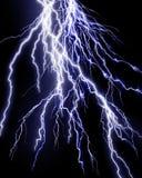 Intense lightning storm. On black background Stock Photos