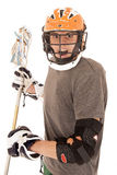 Intense male lacrosse player with helmet and stick. Intense male lacrosse player in uniform helmet Royalty Free Stock Images
