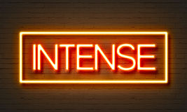 Intense neon sign on brick wall background. Stock Photos