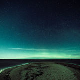 Intense northern lights (Aurora borealis) over Baltic sea Stock Images