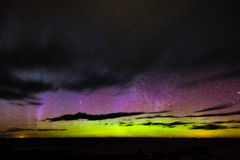 Intense northern lights Aurora borealis over Baltic sea Stock Images
