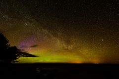 Intense northern lights (Aurora borealis) over Baltic sea Stock Image
