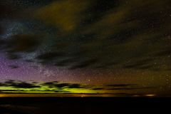 Intense northern lights (Aurora borealis) over Baltic sea Royalty Free Stock Photography