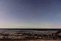 intense northern lights aurora borealis over beach Stock Images