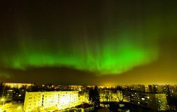 Intense northern lights (Aurora borealis) over city of Riga Royalty Free Stock Image