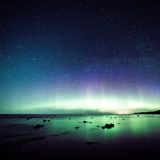 Intense northern lights (Aurora borealis) over Baltic sea Royalty Free Stock Image