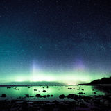 Intense northern lights (Aurora borealis) over Baltic sea Royalty Free Stock Images