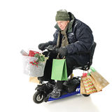 Intense Senior Christmas Shopper Stock Photo