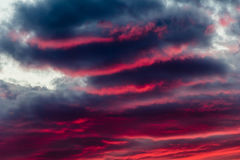 Intense sky away from our window. Mysterious fiery sky at sunset with altocumulus clouds Royalty Free Stock Images