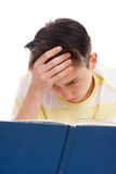 Intense study for exams. A teenage student reading and studying for exams.  White background Stock Photo