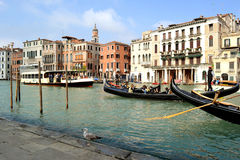 Intense summer water traffic of gondolas and ferries in Venice. Stock Image
