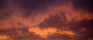 Intense Sunset Clouds Stock Images