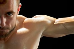 Intense workout of a sportsman. Sweating while lifting heavy weight to build a strong and beautiful body stock image